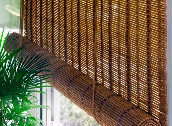 Bamboo curtains for window coverings in interior living room .