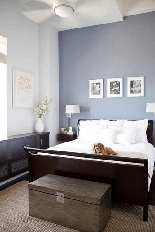 calming colors: white and dark brown furniture with accent wall .