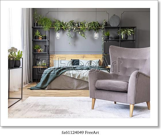 Free art print of Comfy armchair in front of a double bed in a .