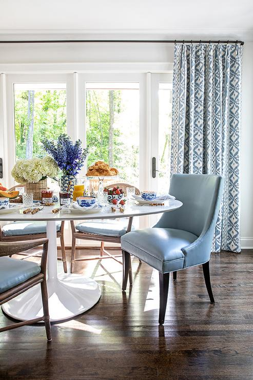 Blue Leather Chairs at Oval Marble Top Dining Table - Transitional .