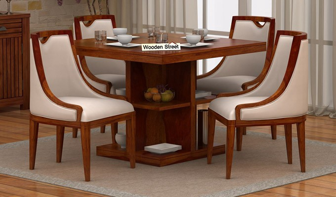 The advantages you get from a four-seater dining table arrangeme