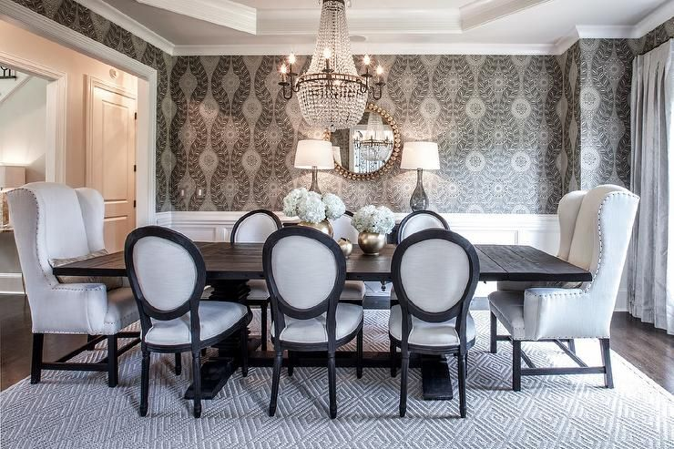 Elegant dining table features an octagon tray ceiling accented .