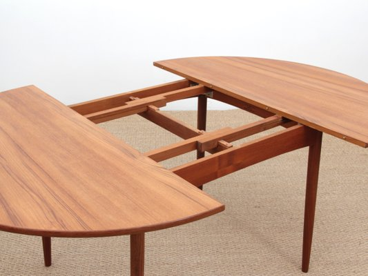 Model 4/6 Round Teak Extendable Dining Table from Elsteds .