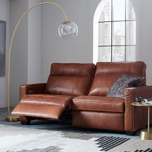 A recliner couch; the perfect combination of style and comfort .