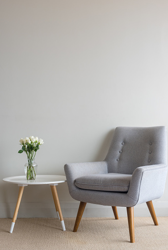 Retro Armchair With Roses On Table Against Wall Stock Photo .
