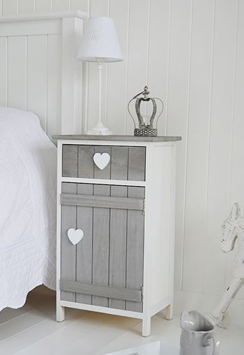 Grey and white Heart Cottage bedside table with cupboard and .