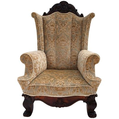 Large Antique Carved Walnut Winged Armchair for sale at Pamo