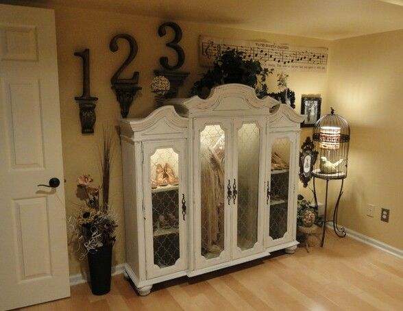 Repurpose the top part of an old china cabinet to display your .