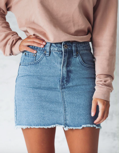 Simple denim skirts can go with so much they make outfits easy .