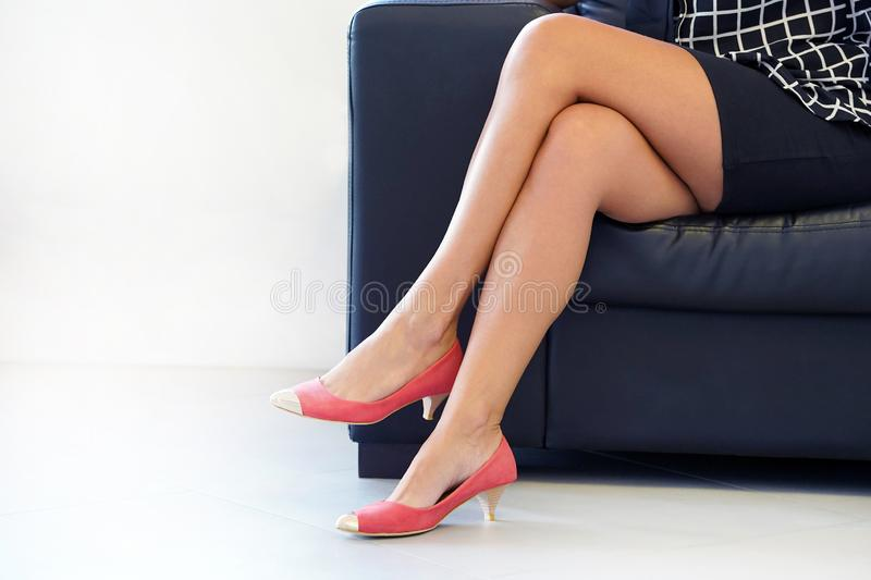 Female Feet In Red Shoes. Criminal Prostitution. Stock Image .